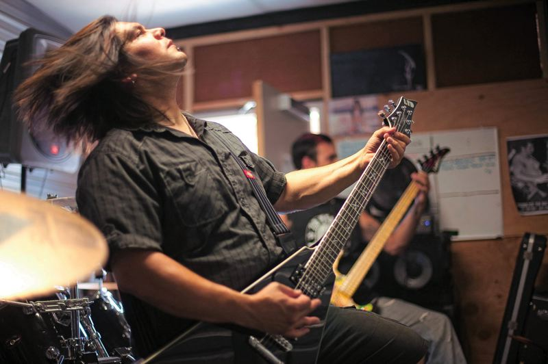 by: TRIBUNE FILE PHOTO: CHRISTOPHER ONSTOTT - Lead guitarist Reuben Valdez jams during a Betrayed by Weakness practice. The Portland group was voted the 16th best metal band in the 2011 Project Independent contest, drawing more than 12,000 votes, and now plans to release its first studio album.