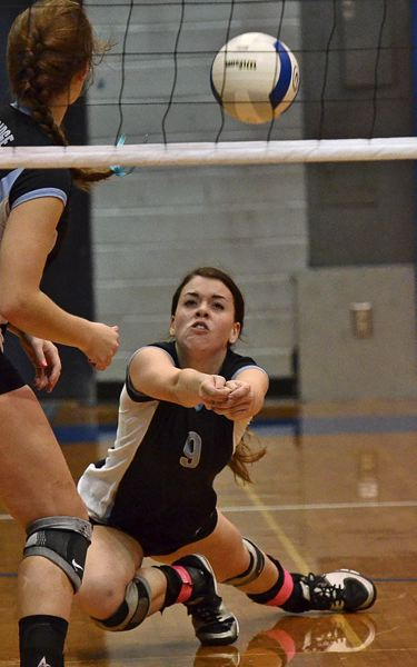 by: VERN UYETAKE - Lakeridge's Kacie Van Stiphout digs a ball during the Pacers' second-round loss to Gresham last week.