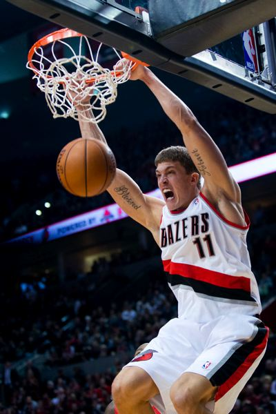by: TRIBUNE PHOTO: CHRISTOPHER ONSTOTT - Joel Freeland dunks for the Trail Blazers in their homecourt loss Thursday night to the Los Angeles Clippers at the Rose Garden.