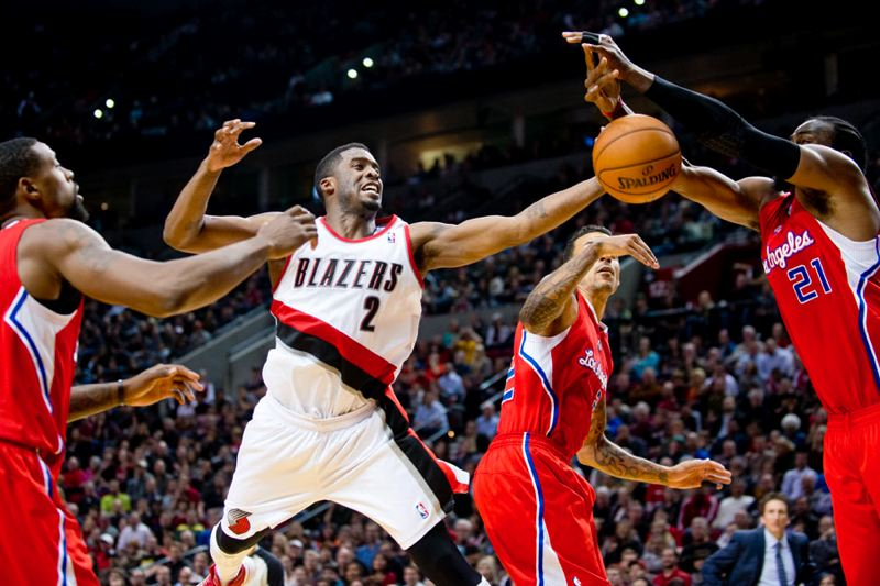 by: TRIBUNE PHOTO: CHRISTOPHER ONSTOTT - Trail Blazers guard Wesley Matthews loses the ball as he drives inside against the Los Angeles Clippers.
