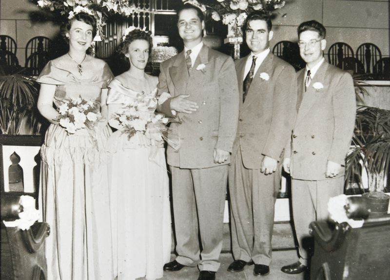 Jim and Marie Bean's wedding photo shows Jim's brother, Claude Ernest Bean, second from right. The two never knew one another until they met while in the Navy, docked at a tiny island in the middle of the Pacific Ocean during WWII. On the far right is Marie's brother, and on the far left, is his girlfriend. CONTRIBUTED PHOTO