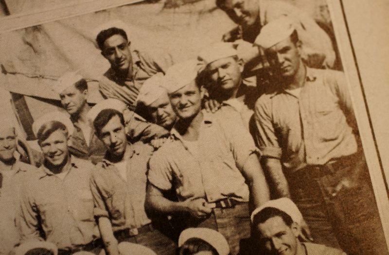 This old photo shows Jim Bean while serving in the South Pacific. He is the sailor in the center, grasping his belt. CONTRIBUTED PHOTO