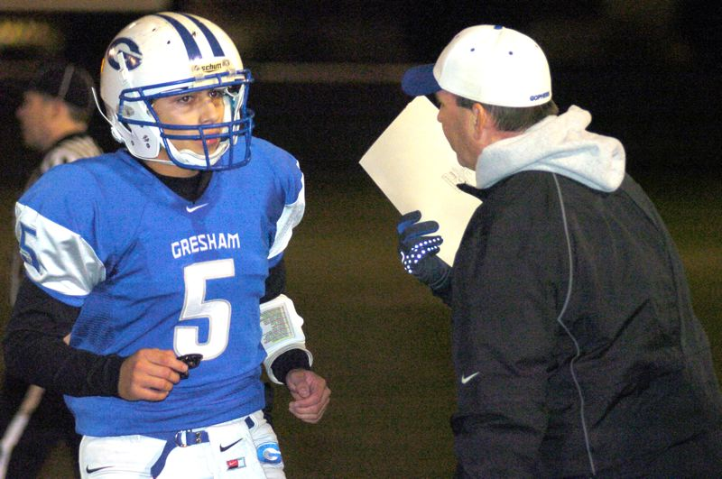 by: THE OUTLOOK: DAVID BALL - Gresham QB Issac Hinojosa gets a play from head coach Todd Nagel during Fridays 39-38 loss to Roseburg.