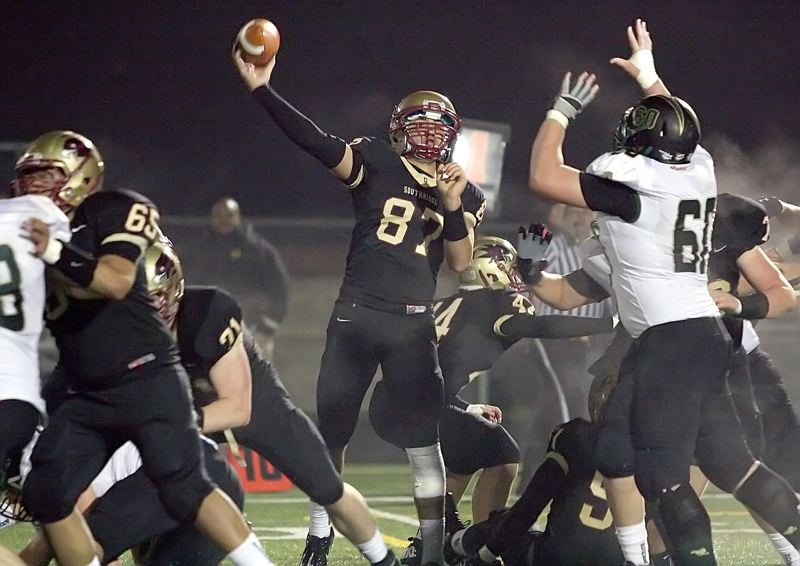by: MILES VANCE - FIRE - Southridge quarterback throws for yardage in his team's 59-14 home win over West Linn in Friday's first round of the Class 6A state playoffs at Southridge High School.