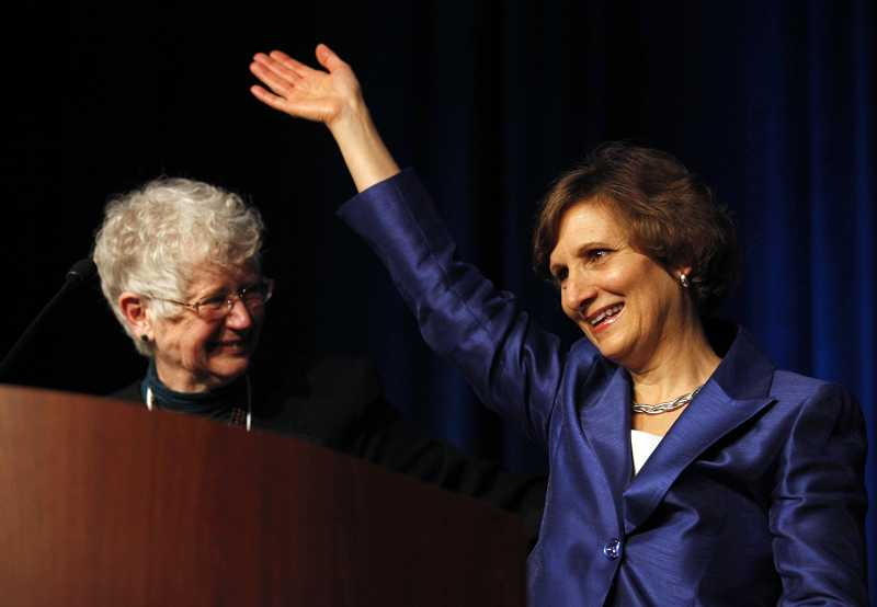by: JONATHAN HOUSE - U.S. Rep. Suzanne Bonamici waves to a crowd of Oregon Democrats after winning her 1st Congressional District race on election night.