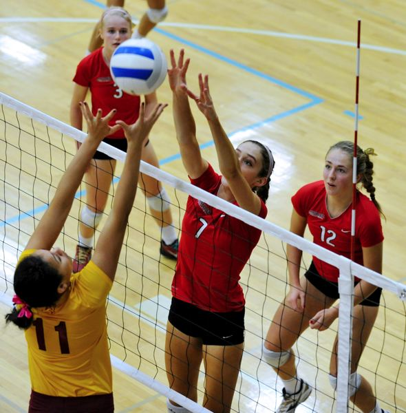by:  JOHN LARIVIERE -     At left, Clackamas junior Taylor Agost (7) battles at the net with Central Catholic sophomore Whitney Turner (11) in Saturdays third-place final of the Class 6A State Volleyball Championships. Clackamas seniors Hannah Stultz (3) and Shelby Vasconcellos-Mattocks (12) stand ready to assist. All three Clackamas players were selected to the all-tournament team.