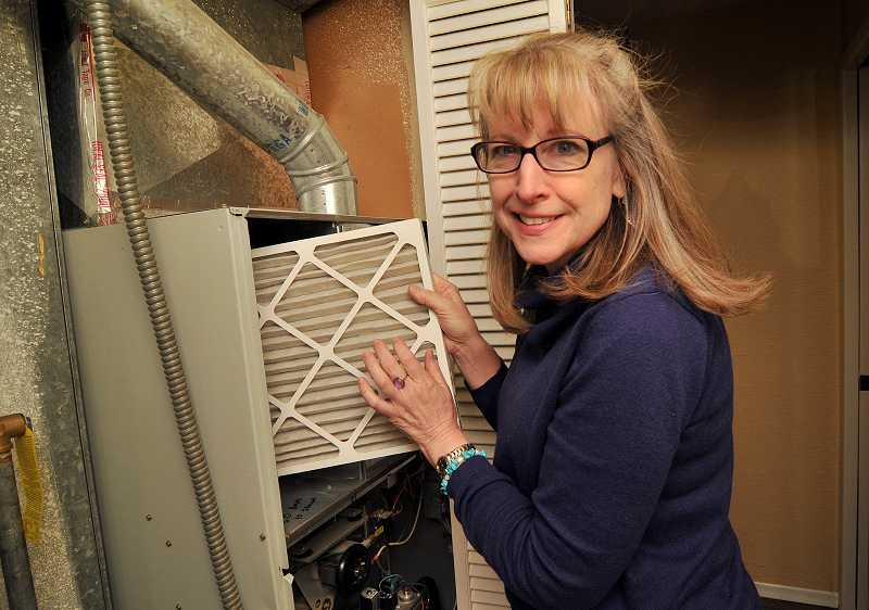 by: REVIEW, TIDINGS PHOTO: VERN UYETAKE - Marcia Lynch's home energy review from Energy Trust of Oregon examined her home heating system, appliances, insulation and more.