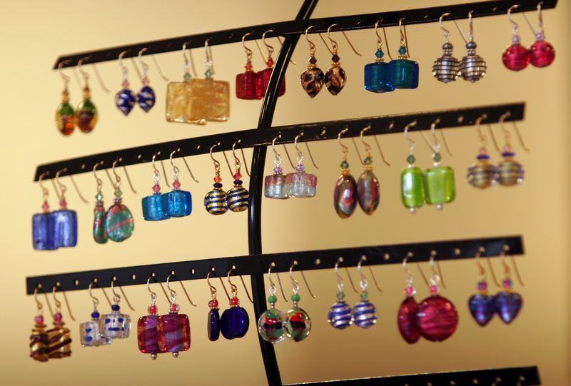 by: OUTLOOK PHOTO: JIM CLARK - A display of earrings at Marco Polo Designs in Troutdale.