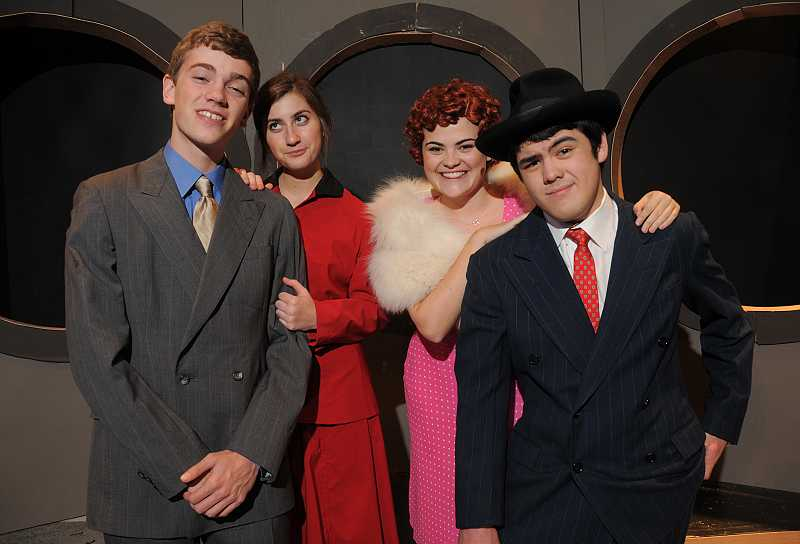 by: REVIEW PHOTOS: VERN UYETAKE - Appearing in the production of Guys and Dolls are, from left, Marjin Burger as Sky Masterson, Anna Ketterling as Sarah Brown, Celeste Spangler as Miss Adelaide and Nick LeSage as Nathan Detroit.