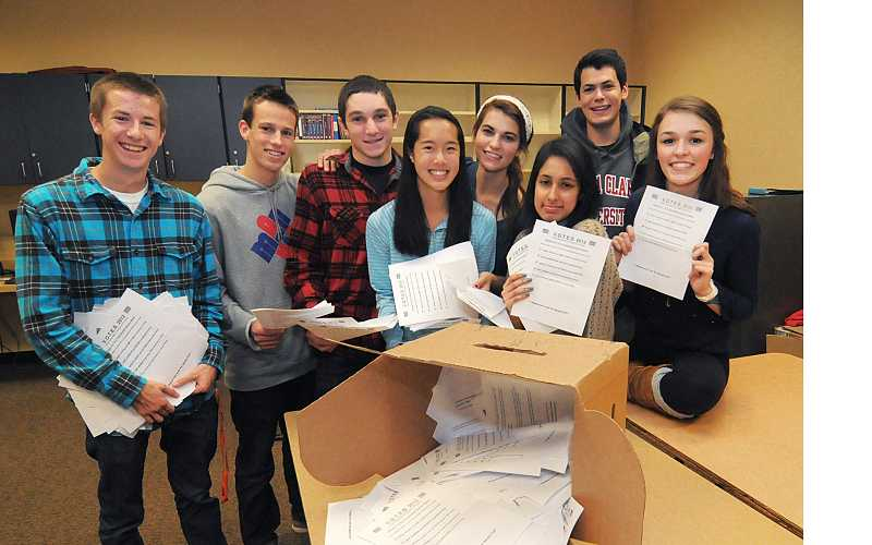 by: REVIEW PHOTO - From left, Political Action Seminar students Ike Worth, Kurt Schimmelbusch, Bowen Mechigian, Zoe Wong, Mehek Sethi, Megan Ten Berge, Emily Wolfram and Andrew Rockwell, organized a mock political election at Lake Oswego High School prior to the national election.