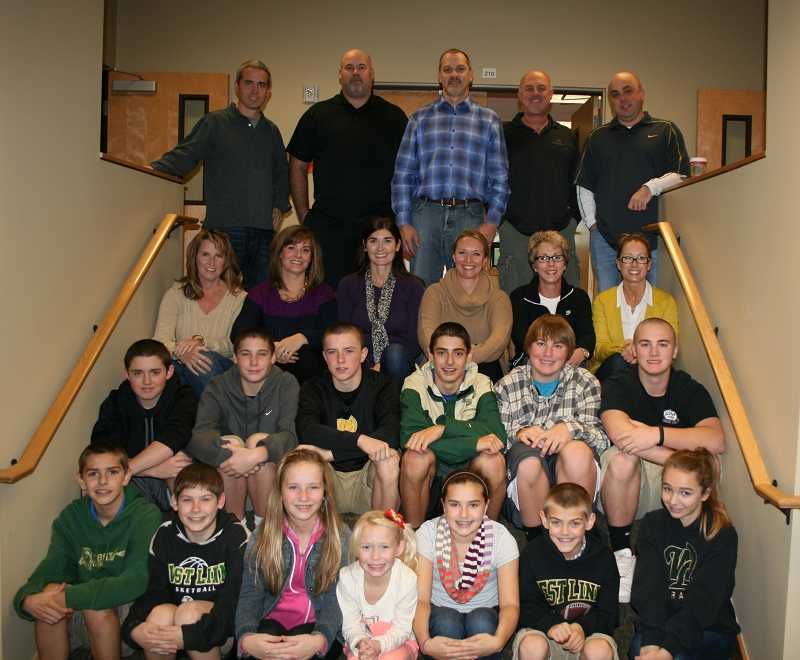 by: SUBMITTED - Volunteers helped serve the Night Before Thanksgiving dinner last year. Back row: Brian Pearce, Dave Johnson, Doug Berggren, Kirk Becker, Steve Pene. Third Row: Misty Pene, Heather Berggren, Shannon Johnson, Pam Pearce, Claire Becker and Brenda Maxwell. Second row: Graham Pearce, Mitch Johnson, Brayden Pene, Connor Berggren, Zeb Becker and Gus Becker. First row: Clint Berggren, Andrew Johnson, Ellie Pearce, Holly Pearce, Brooke Pene, Cooper Berggren and Mackenna Koppler.