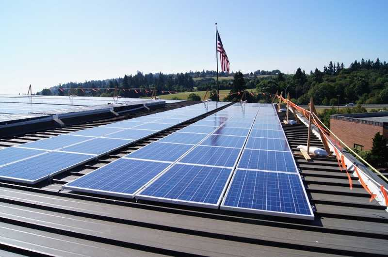 by: SUBMITTED PHOTO - Solar panels like the ones shown here have been installed on Rolling Hills Community Churchs rooftop, as part of an agreement between the church and local solar energy firm NW Photon Energy.