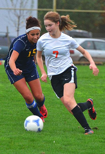 by: JOHN BREWINGTON - Scappoose's Lucy Davidson brings the ball downfield during last week's game with Brookings-Harbor.
