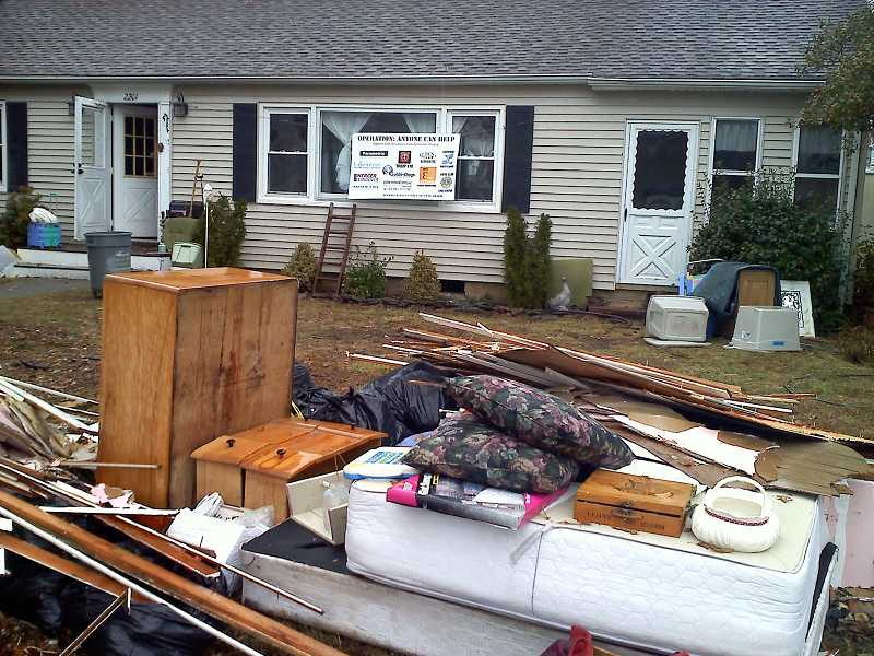 by: SUBMITTED - Piles and piles of debris greeted relief workers who flocked to Point Pleasant, N.J.