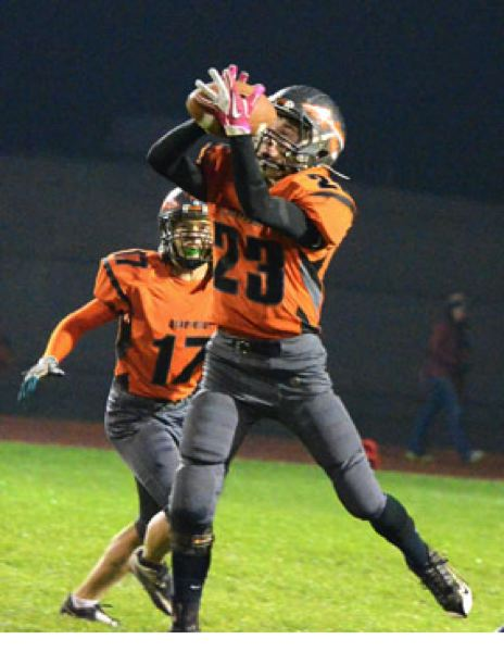 by: JOHN BREWINGTON - Scappoose's Matt Shoun intercepted Madras on the first play of the game. He had two picks in the first quarter. The Indians would intercept six passes in the contest.