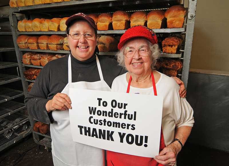 by: VERN UYETAKE - Upper Crust Bread Co. owner Alice Seeger, left, and her mother, Phyllis, hold a sign letting customers know they're preparing to close the bakery at 41 B Ave.