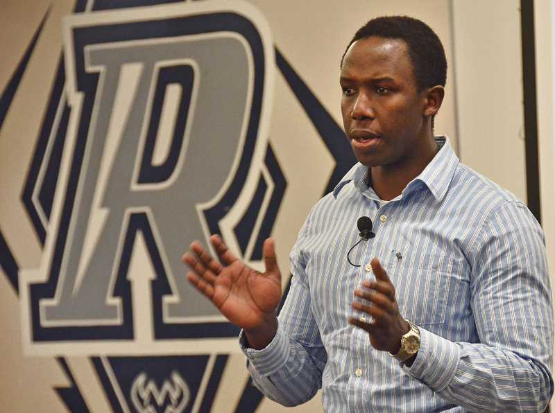 by: REVIEW PHOTOS  - Emmanuel Habimana, a genocide survivor from Rwanda, addressed students at Riverdale High School last week, telling them about his experiences.