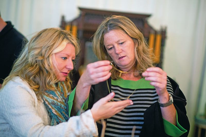 by: TRIBUNE PHOTO: CHRISTOPHER ONSTOTT - Jessica Spencer (left) and Julie Dieringer look at a necklace while shopping at a pop-up shop in downtown Portland.