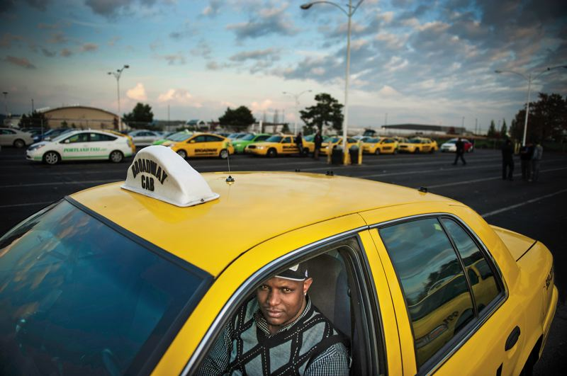by: TRIBUNE PHOTO: CHRISTOPHER ONSTOTT - Portland officials are hoping to discourage cab drivers from waiting in line at the airport bullpen. Broadway Cab driver Dacho Geda is among those willing to wait as long as two hours for a ride.