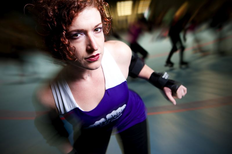 by: TRIBUNE PHOTO: CHRISTOPHER ONSTOTT - Texine of the Rose City Rollers says her hips are registered weapons. Not really, but they can be dangerous.