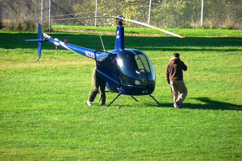 by: DREW DAKESSIAN - The helicopter from Hillsboro Aviation that made an emergency landing at Robert Gray Middle School Thursday morning