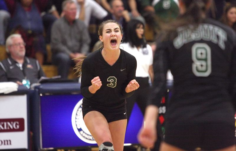 by: MILES VANCE - WE WIN - Jesuit senior Megan McCool lets out a scream after the Crusaders won the final point in her team's five-game victory over Roseburg in the Class 6A state championship at Liberty High School in Hillsboro on Saturday night.