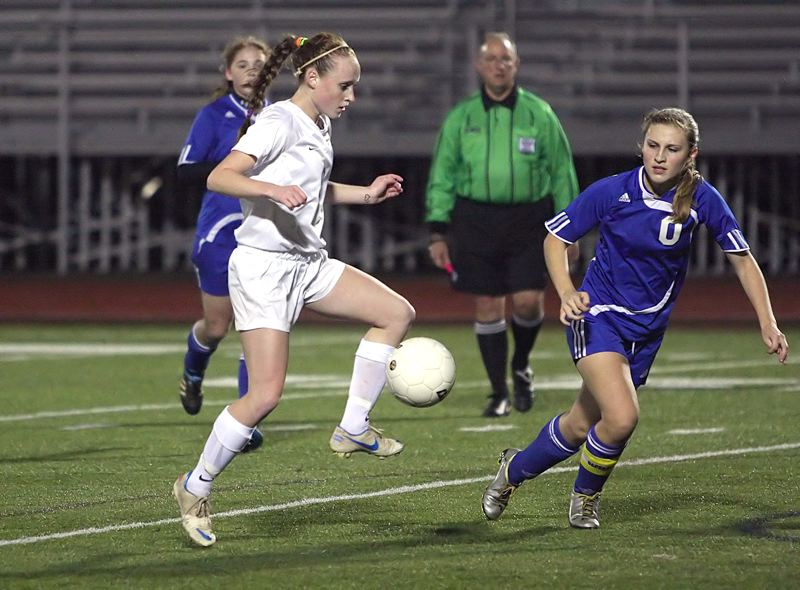 by: MILES VANCE - WINNING - Valley Catholic's Sarah Connelly heads upfield while defended by Glide's Madison Gladding during the Valiants' 1-0 win in the Class 3A/2A/1A state semifinals on Tuesday at Hare Field in Hillsboro.