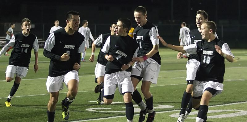 by: MILES VANCE - GOOAAALL - Jesuit's Tyler Street (center) is surrounded by teammates (from left) Chase Boone, Matt Nachreiner, Shane Richards, Spencer Scott and Pierce Baldocchi after his goal against Sunset on Tuesday.