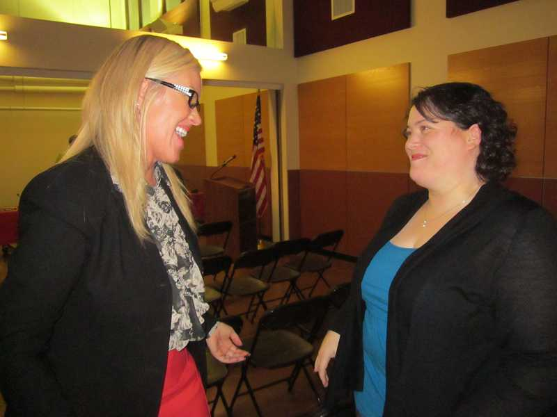 by: BARBARA SHERMAN - Heather Cordie, Sherwood School District superintendent, (left) congratulates Jessica Adamson on her appointment to the Sherwood School Board Nov. 14.