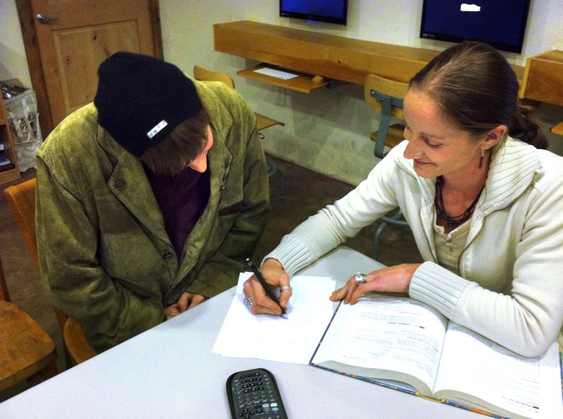 by: CONTRIBUTED PHOTO - Intern Tess Brookhart, right, works with Ethan Stubbs in preparation for his GED.