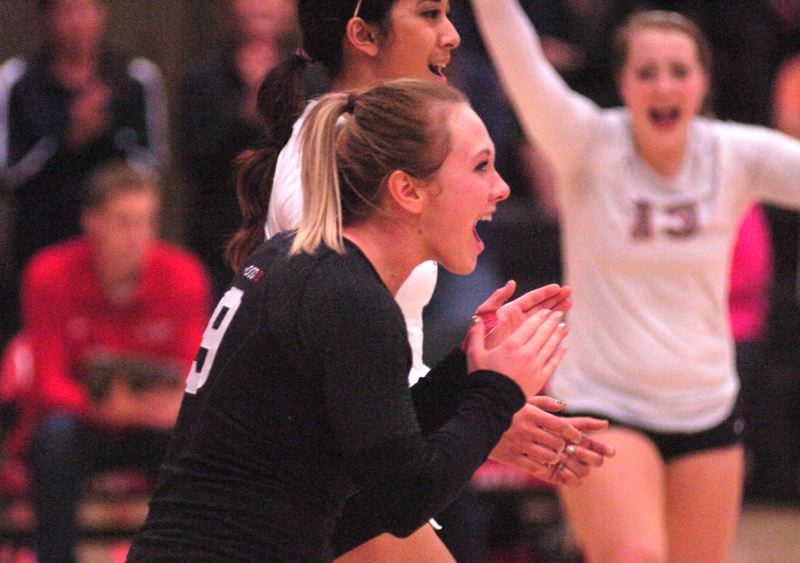 by: THE OUTLOOK: DAVID BALL - Mt. Hood CC libero Kelsey Merritt celebrates a point during the teams first-round win over Wenatchee Valley on Thursday.