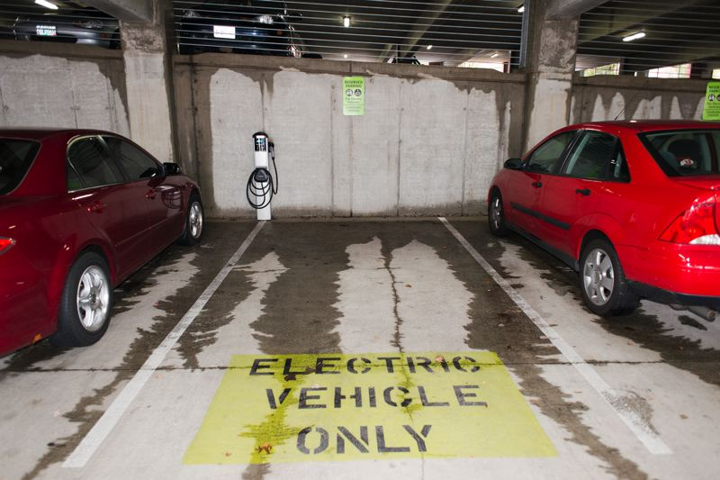 by: TRIBUNE PHOTO: CHASE ALLGOOD - Electric vehicle charging stations are located at the Hillsboro Intermodul Transit Facility, 775 S.E. Baseline.