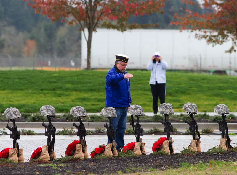 by: TRIBUNE PHOTO: CHASE ALLGOOD -  A wreath is laid on a display in honor Hospitalman Riley Gallinger-Long for the Roll Call of the Fallen during the Veterans Day Ceremony at Veterans Gateway in Hillsboro.
