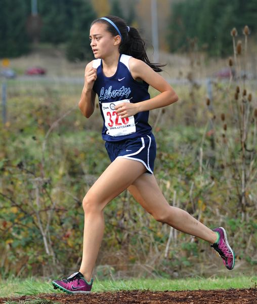 by: TRIBUNE PHOTO BY ZACK PALMER - Liberty freshman Rachel Khaw runs at the Class 5A state cross country meet on Nov. 3 at Lane Community College. Khaw finished 10th overall with a time of 19:35, and she led the Falcons to a 10th-place team finish, two spots higher than predicted.