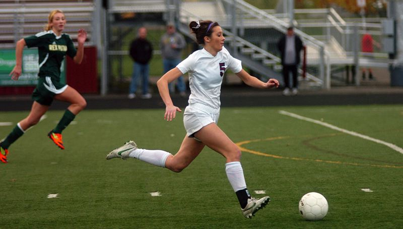 by: DAN BROOD - STRIDING -- Sherwood senior Meghan Schoen takes off toward the Rex Putnam goal in Saturday's state playoff quarterfinal match.