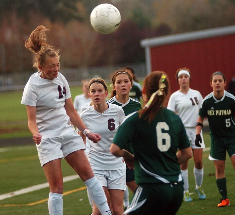 by: DAN BROOD - HEAD GAMES -- Sherwood senior Mikayla Howes (left) gets her head on the ball during Saturday's state quarterfinal win over Rex Putnam.
