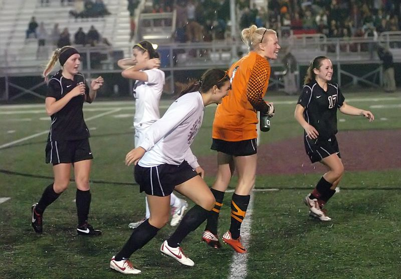 by: DAN BROOD - ON TO THE FINALS -- The Sherwood girls soccer team, including Taylor Gersch, Rojia Stocker, Kyeli Hendryx and Michaela Pilkenton begin celebrating following the 2-1 semifinal win at Willamette.