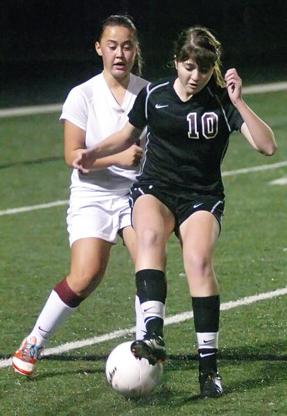 by: DAN BROOD - IN CHARGE -- Sherwood sophomore Sarah Garoutte keeps control of the ball in front of Willamette sophomore Michaela Herring during Tuesday's state semifinal contest.