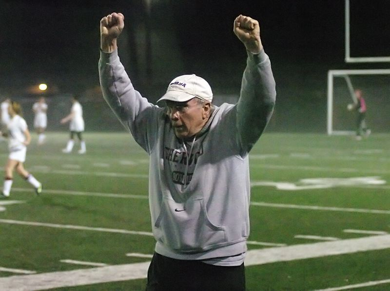 by: DAN BROOD - ARMS UP -- Sherwood coach Bill Brown puts his arms up high following the Lady Bowmen's first goal in Tuesday's win at Willamette.