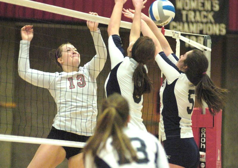 by: THE OUTLOOK: DAVID BALL - Mt. Hoods Tori Kemper goes above the net for a kill off a Bellevue block. She finished with a team-best 15 kills.