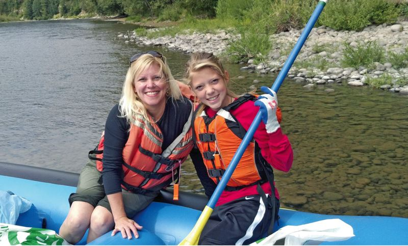 by: SUBMITTED - Patty Ottaway and her daughter, Gillian Watts, are raring to go down the Clackamas River at the 2012 SOLV River Clean Up. This is their third year as members of the Sunnyside chapter of the National Charity League.