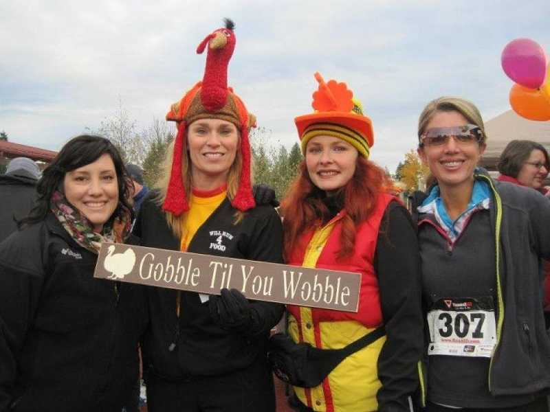 by: SUBMITTED PHOTO COURTESY OF CINDY AGGSON - This year's Give n' Gobble walk/run is set for Thanksgiving Day at 9 a.m. at the Sherwood High School Stadium. Past supporters of the event include, from left, Amber Gardner, Shelly Rath, Randy Jo Stewart and Debbie Mylander