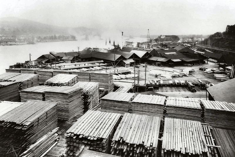 by: COURTESY OF THE SMILE HISTORY COMMITTEE - A view of the Eastside Lumber Mill in 1925, looking north. Stacks of finished lumber were laid on drying racks until they were ready to ship by rail.