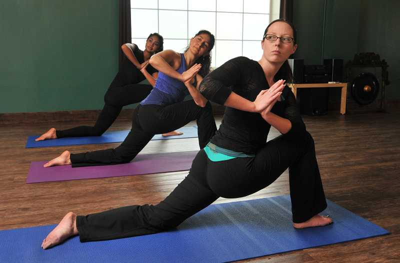 by: REVIEW, TIDINGS PHOTO: VERN UYETAKE - Imagine Yoga Studio owner Laura Campbell (right) and her husband, Shannon, opened the studio Nov. 1.