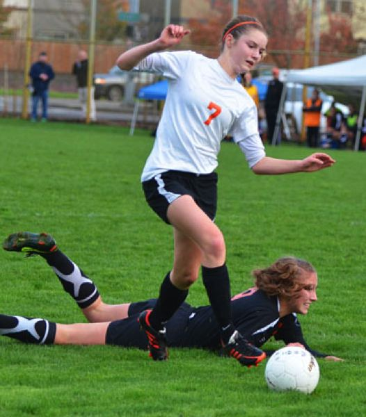 by: JOHN BREWINGTON - Scappoose's Lucy Davidson outfought a Gladstone player for the ball and moved the ball down the field during Tuesday's semifinal match. The Lady Indians hosted Gladstone, but lost 4-1. Gladstone would win the state championship on Saturday.