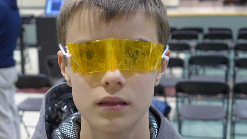 by: SUBMITTED PHOTO - Hunter Crawford looked through yellow cellophane to simulate the affects of yellowing on vision.