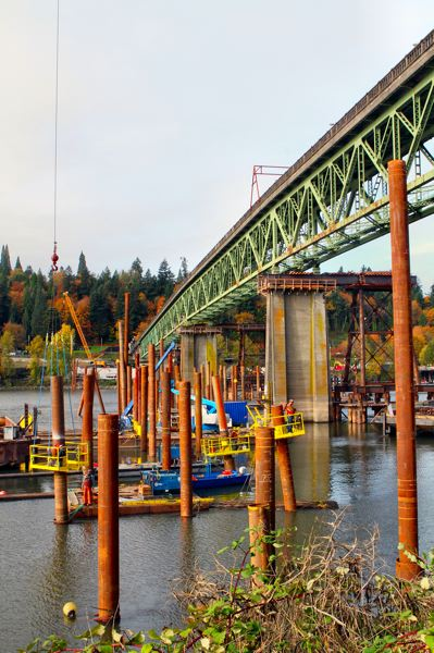by: DAVID F. ASHTON - This 'jungle of pilings' will one day support the eastside work bridge, from which construction will progress on the brand new Sellwood Bridge.