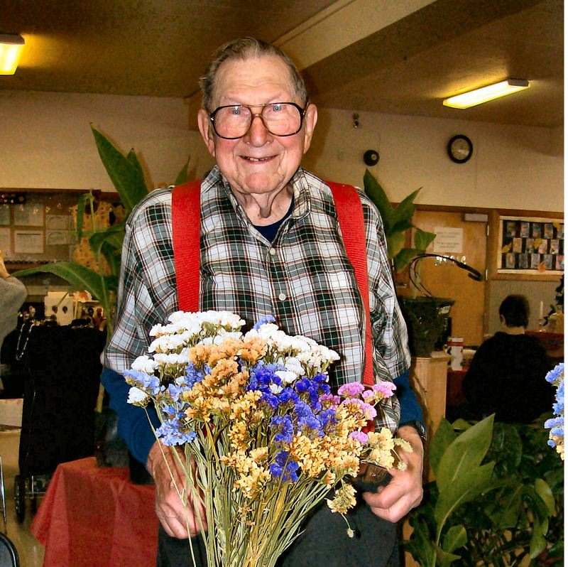 by: RITA A. LEONARD - Plant Booth vendor Jim Germann has been a fixture at the St. Agatha Bazaar for 50 years.