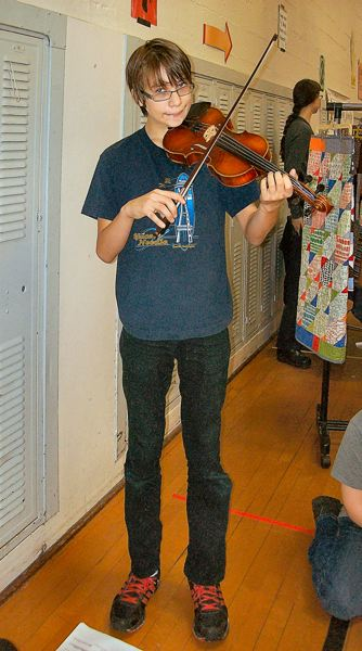 by: RITA A. LEONARD - Former Llewellyn student Nicolas Avendano plays violin at the 2012 Llewellyn Holiday Market.