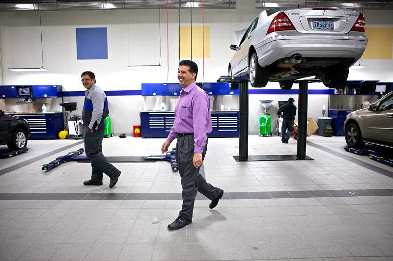 by: JAIME VALDEZ - Mercedes-Benz of Beaverton's General Manager Terry Tallerino takes a stroll through the spotless new service center at the new dealership on Southwest Canyon Road.